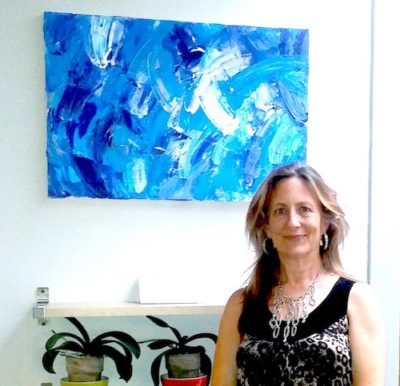 Janet Gervers in front of Blue Splash Painting 2017